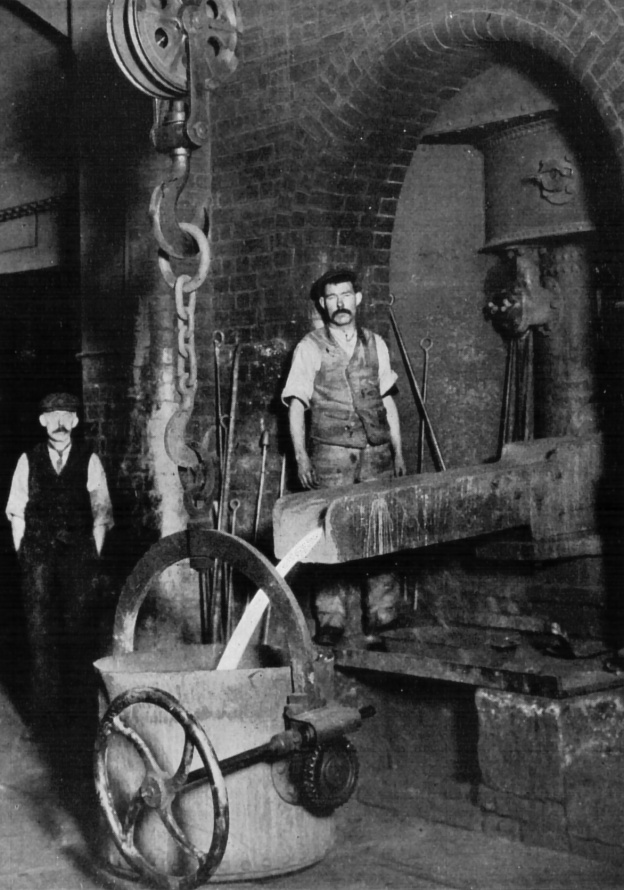 13191-two-men-working-in-an-iron-foundry-or